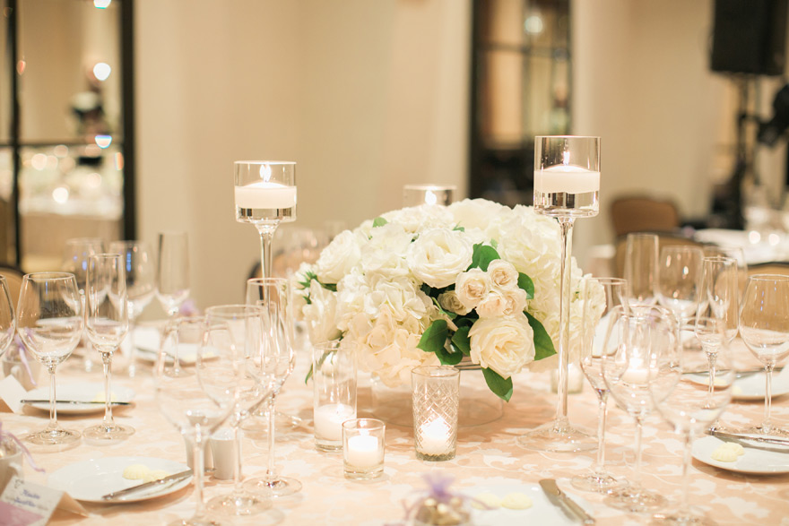 ballroom reception with candlelight and white flowers
