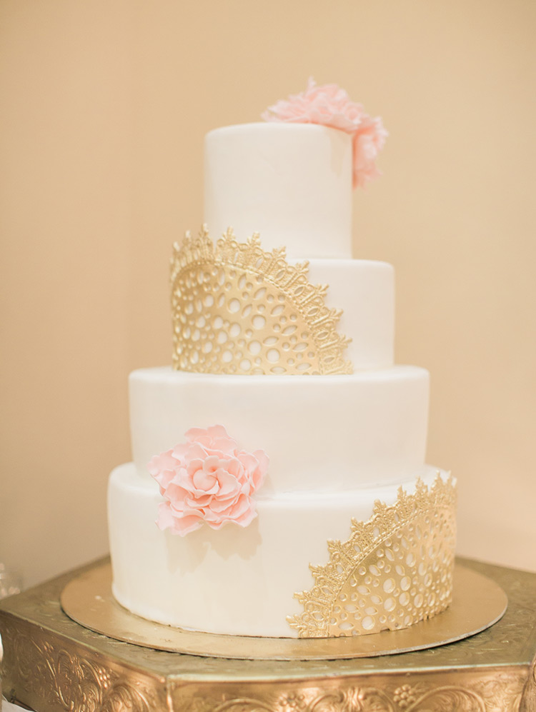 wedding cake with gold lace and sugar flowers