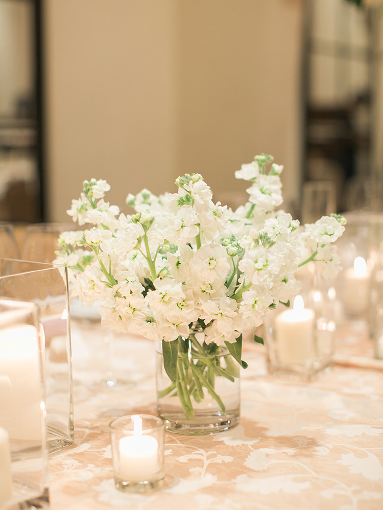 wedding reception centerpiece of delicate white flowers