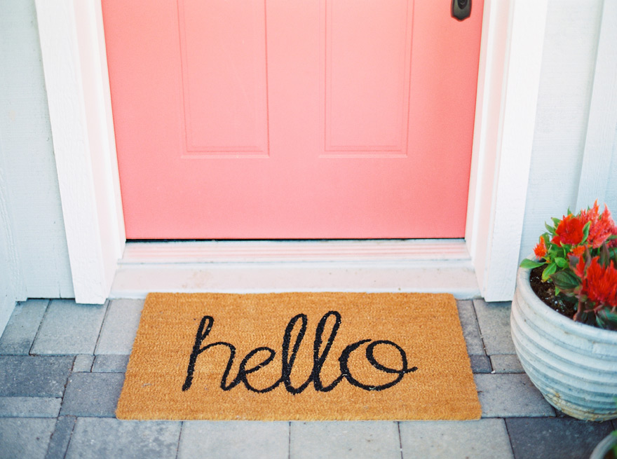 Pink door with welcome mat