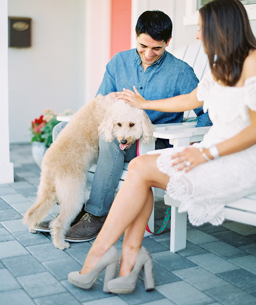 Spending time together on the front porch with their labradoodle
