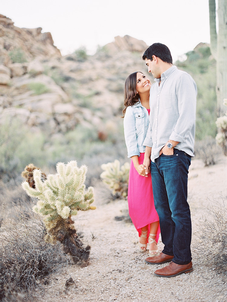 Loving couple in a desert engagement session