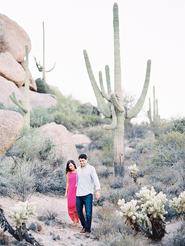 Vibrant pink dress stands out in the desert, engagement photos