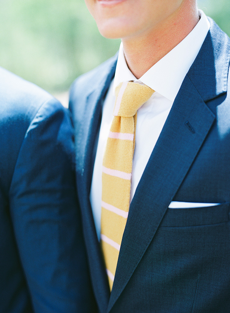 Groomsmen in blue suit with custom knit ties