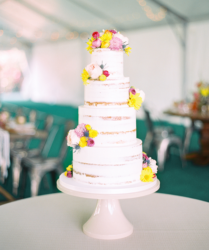 nearly naked cake by Heartsweet Cakes at a boho wedding