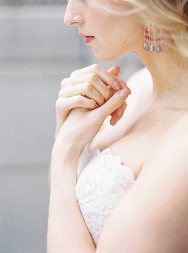 Bridal beauty with berry lips, pinky-nude nails, and a loose up-do.