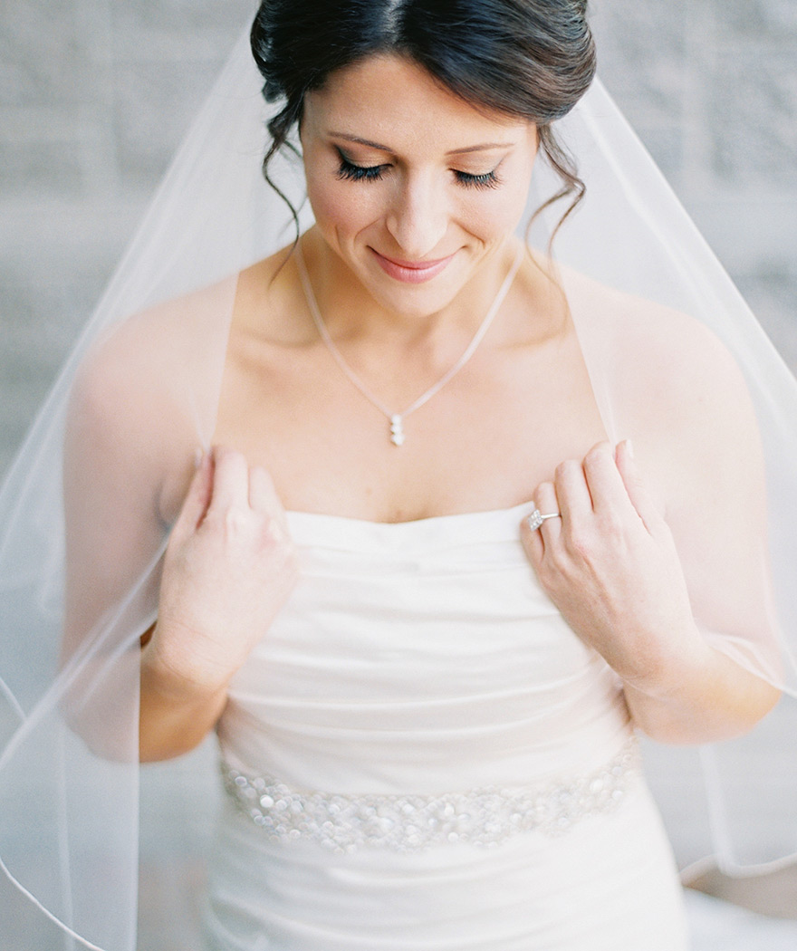 strapless wedding dress and fingertip-length veil