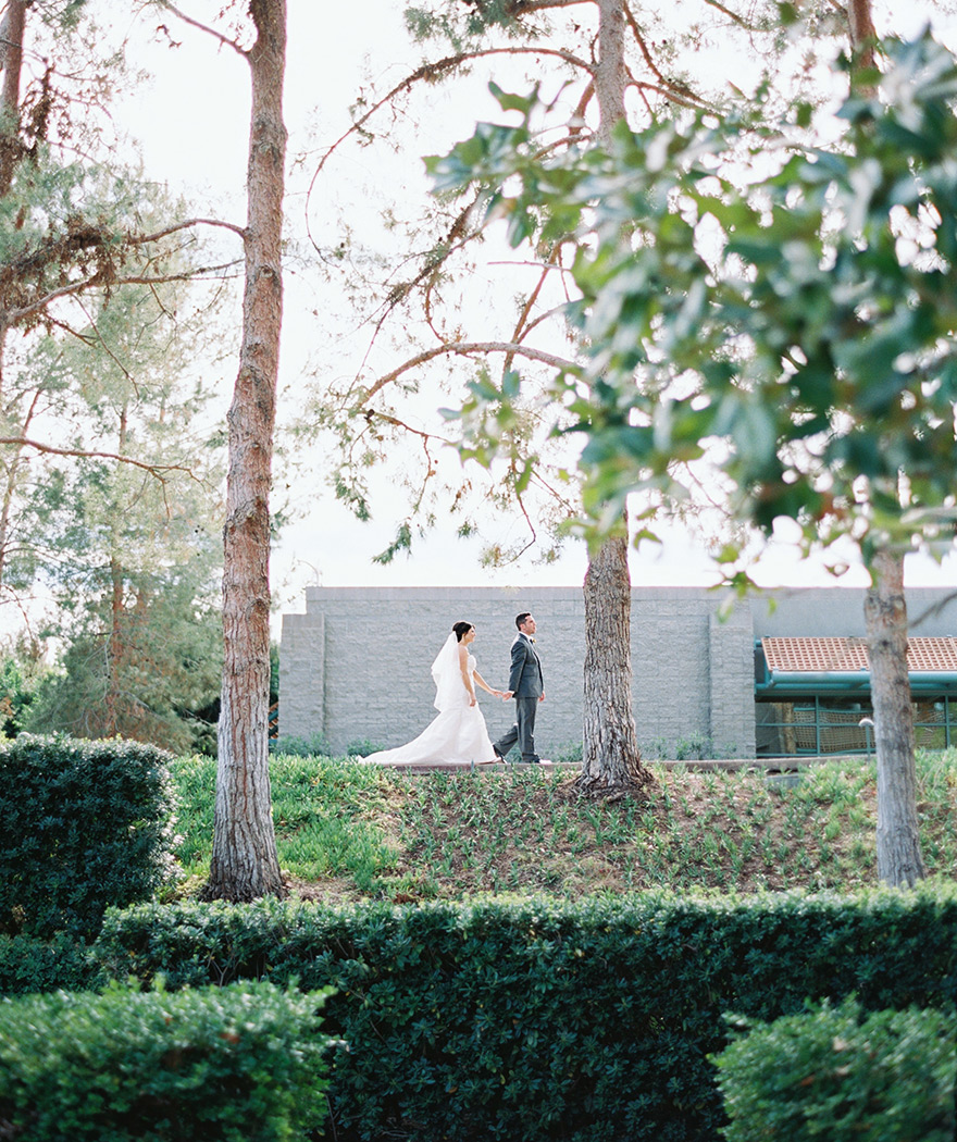 bride & groom walk hand-in-hand at Hyatt Scottsdale