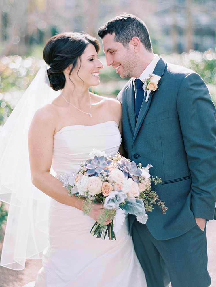 elegant bride & groom, pale peach bouquet with succulents & dusty miller