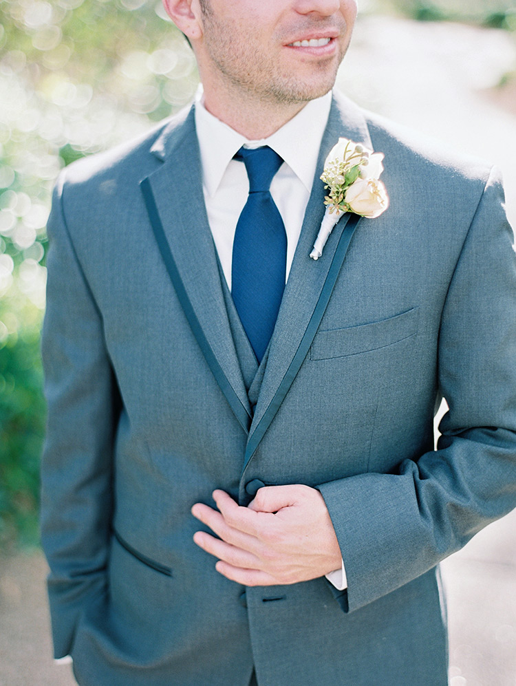 groom in a grey three-piece suit