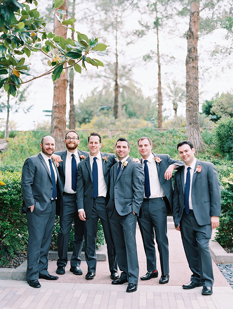 groomsmen in grey suits with blue ties