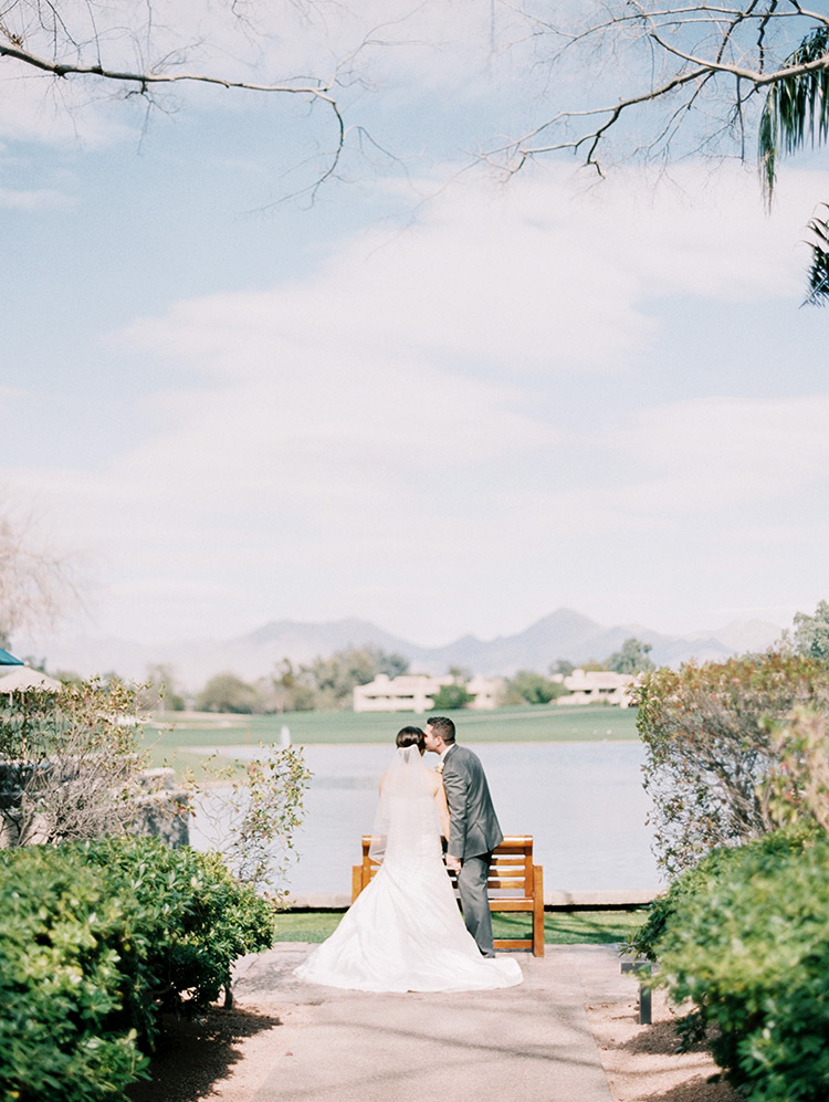 bride & groom kiss by the water, Phoenix wedding