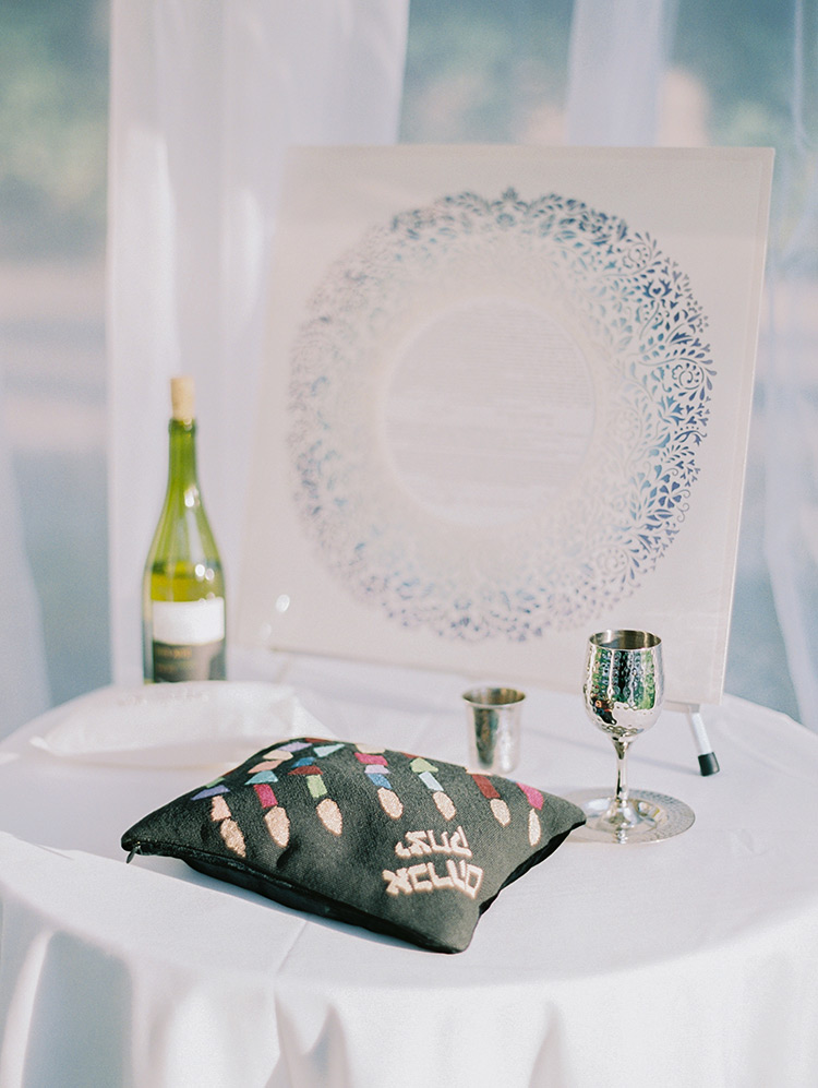 ketubah and kiddish cup wait for the wedding ceremony