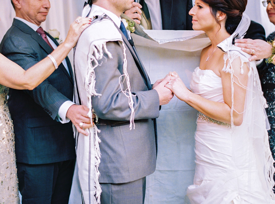 bride & groom surrounded by family & wrapped in the tallit
