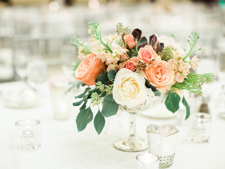 ballroom wedding reception with peach & blush flowers