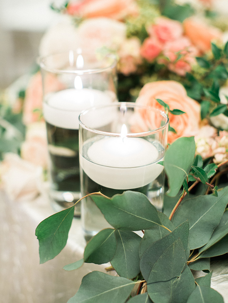 peach & blush flowers with greenery & candles, wedding reception