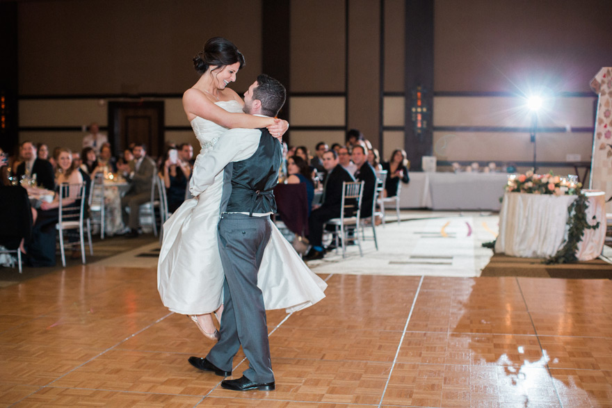 bride & groom share a choreographed first dance, wedding reception