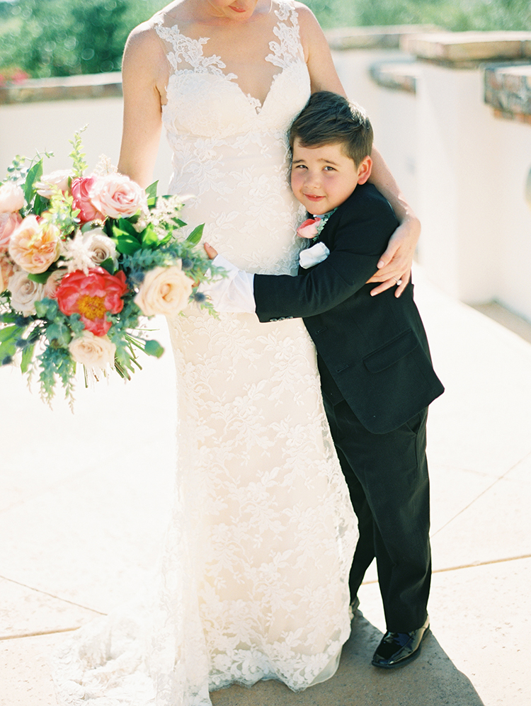 bride in lace and her loving son