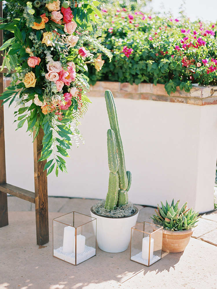 outdoor wedding with spring flowers, candles, and cacti