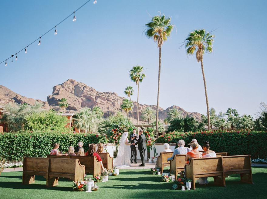 intimate outdoor wedding with wooden pews