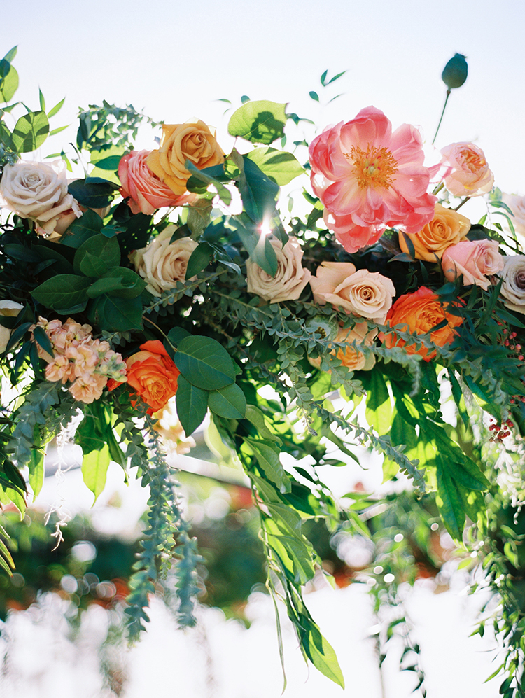 wedding reception decor - florals suspended above the table
