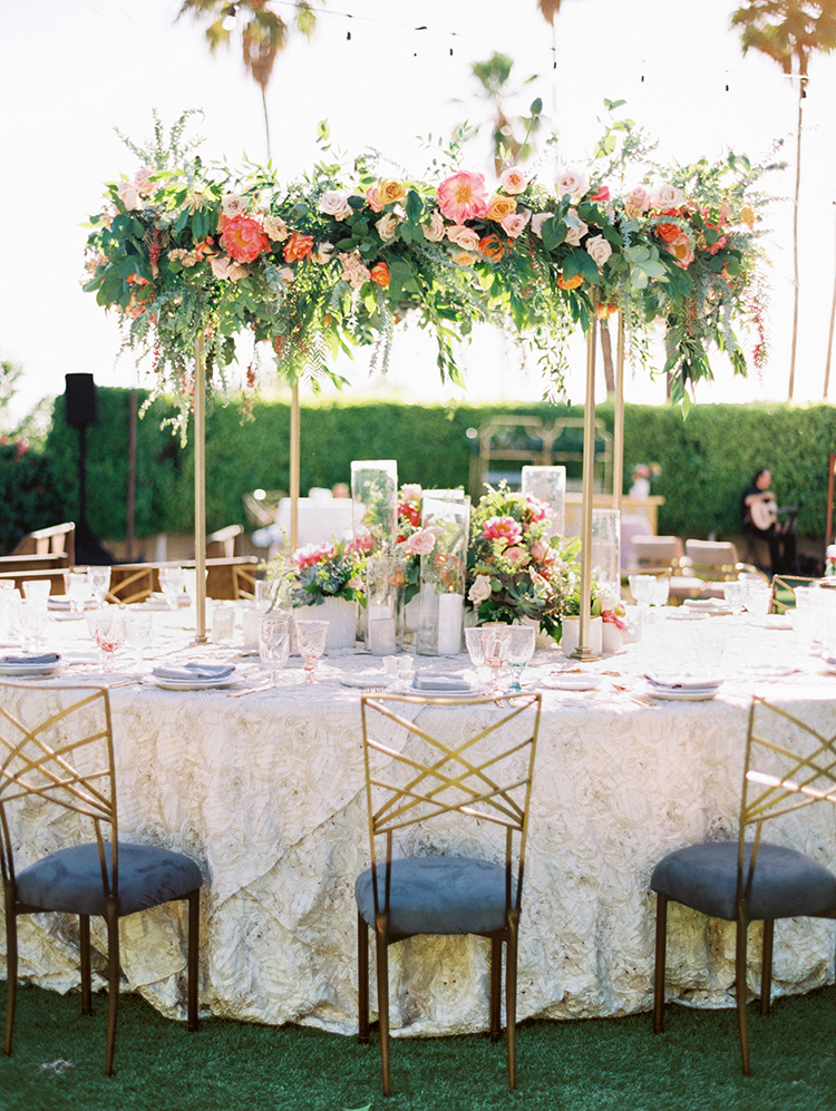 outdoor wedding reception with hanging florals
