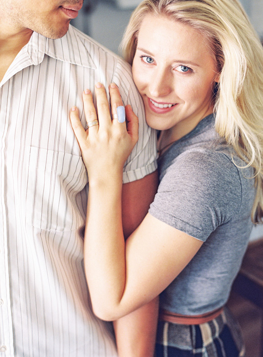 Coordinating neutral wardrobe, cozy home engagement session.