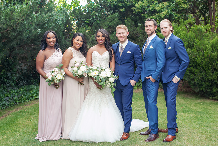 Blue suits for the groomsmen and pale lace for the bridesmaids