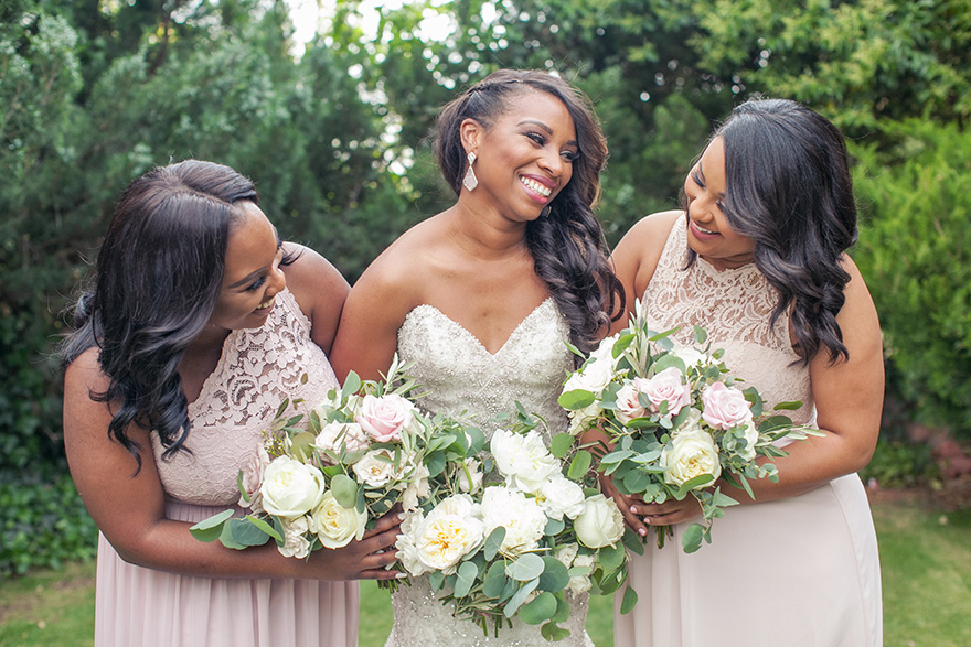 Bridesmaids in blush and cream lace