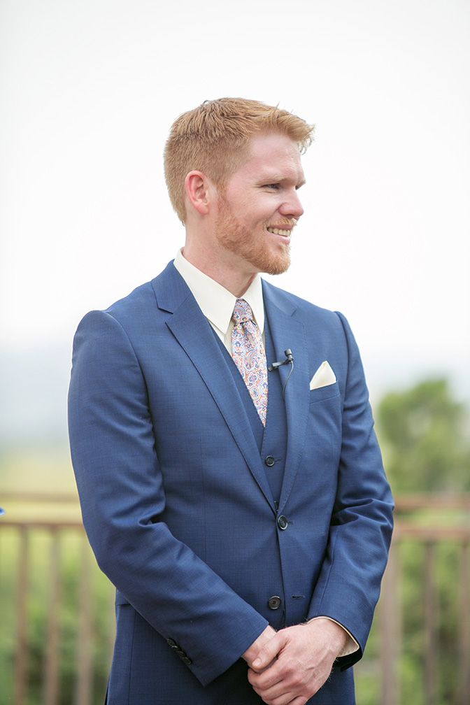 groom in a blue suit with a paisley tie