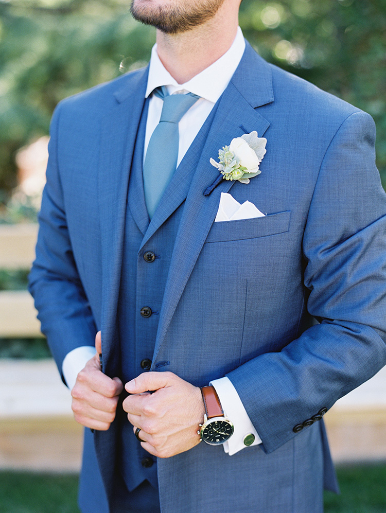 stylish groom in blue three piece suit