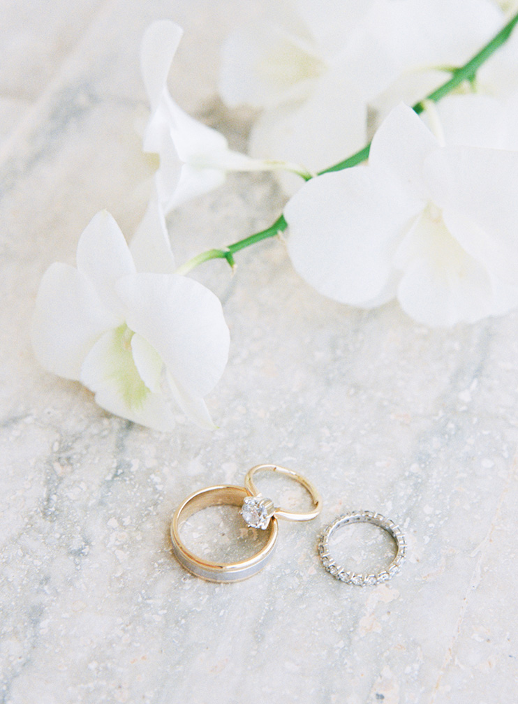 wedding rings with white orchids