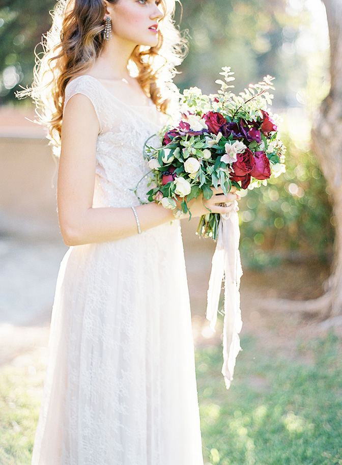 long curls, beaded gown and romantic red bouquet