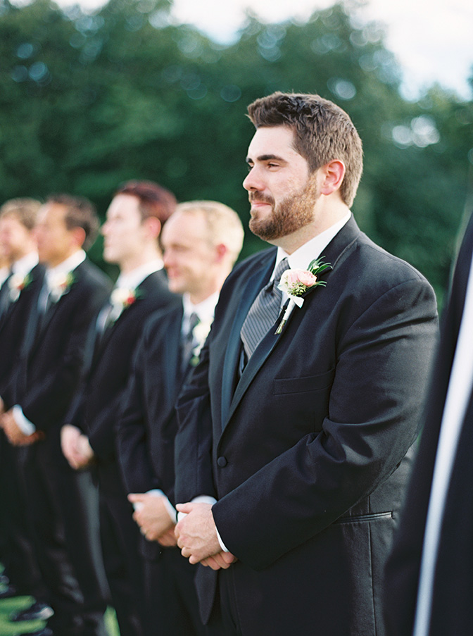 teary groom awaits his bride