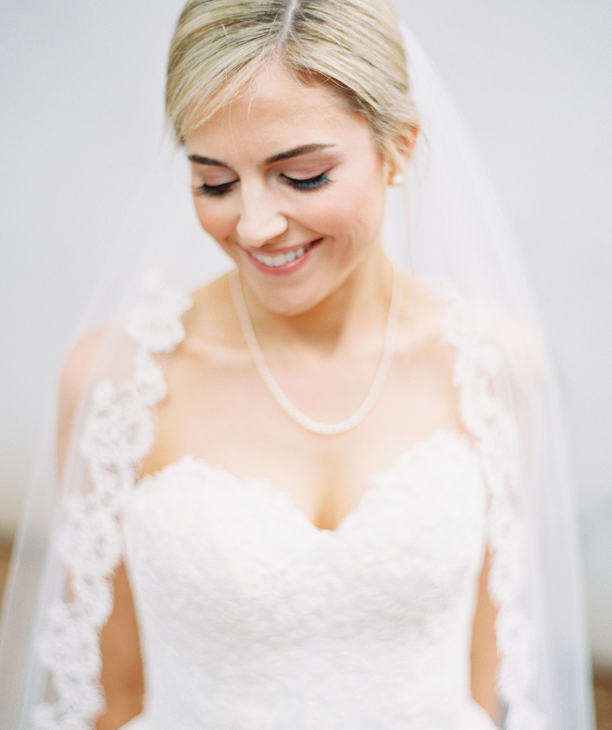 lace-edged veil frames the bride's face