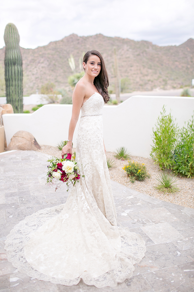 Beautiful bride with long, loose hair in a lace Maggie Sottero dress. Desert wedding