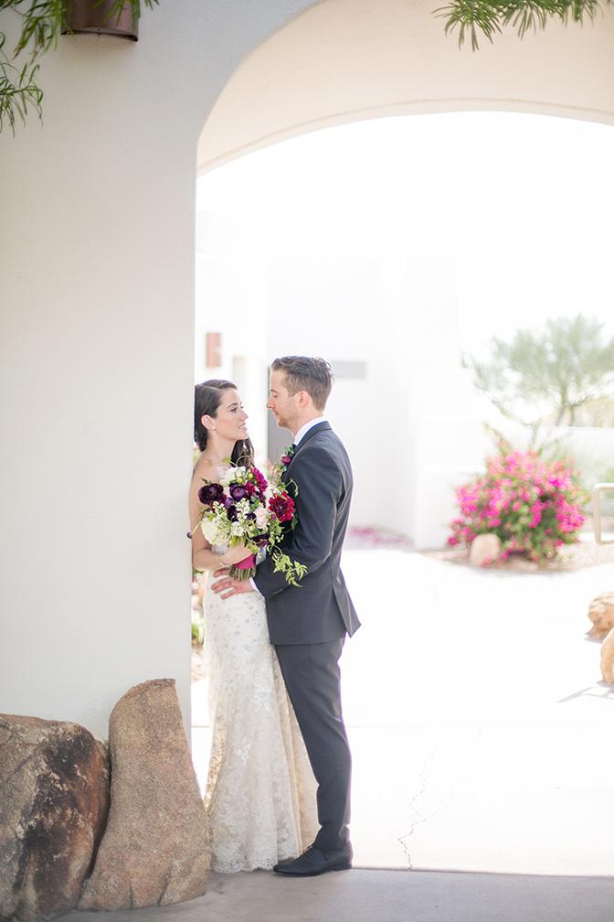 Private moment between the bride & groom. Desert wedding