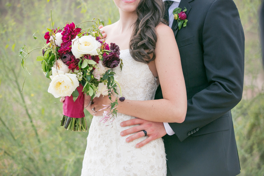 Lush, modern bouquet with white and burgundy, lace wedding dress, from in black