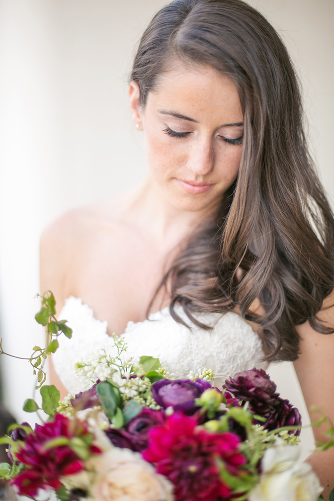 Stunning bride with loose brown hair, wine tone bouquet