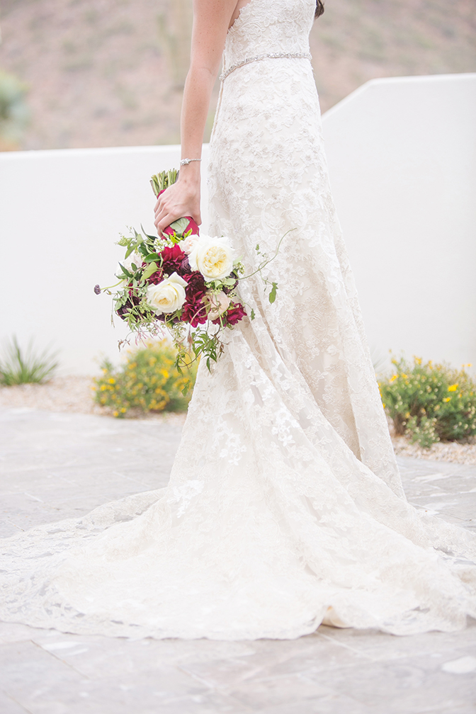 Lace Maggie Sottero dress and a lush, modern bouquet with white and burgundy. Desert wedding