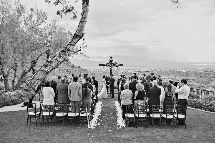 Outdoor wedding ceremony overlooking the Phoenix valley. Large cross decorated with flowers
