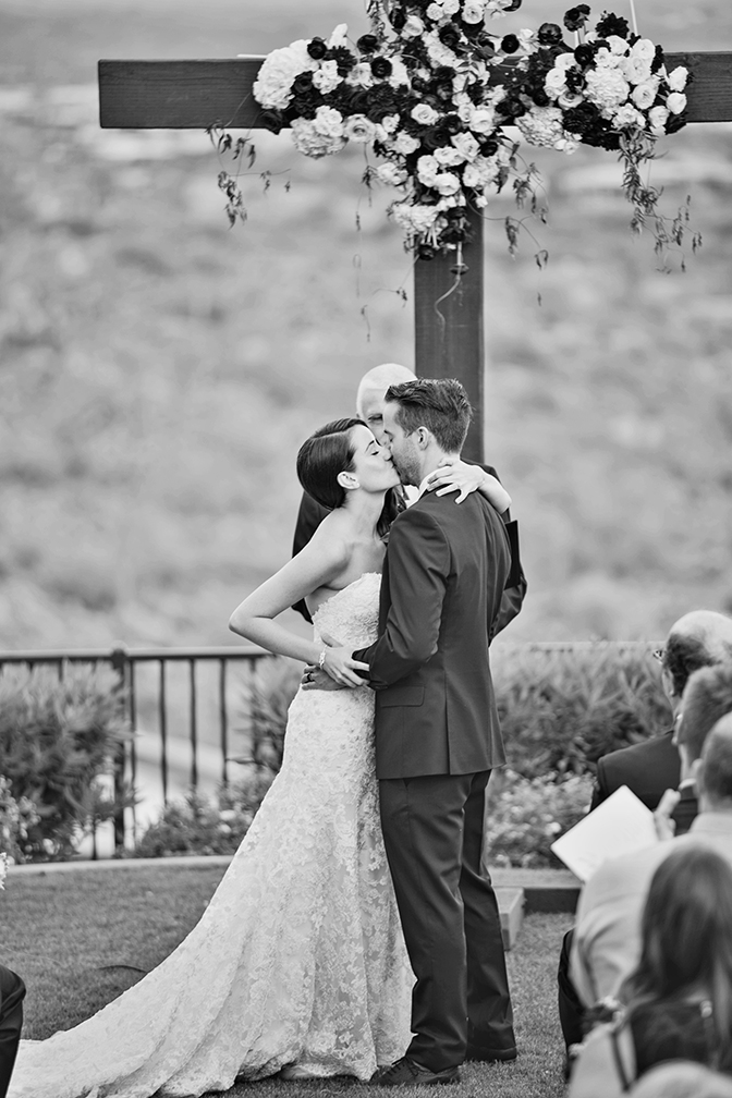 First kiss as man and wife! Outdoor wedding ceremony