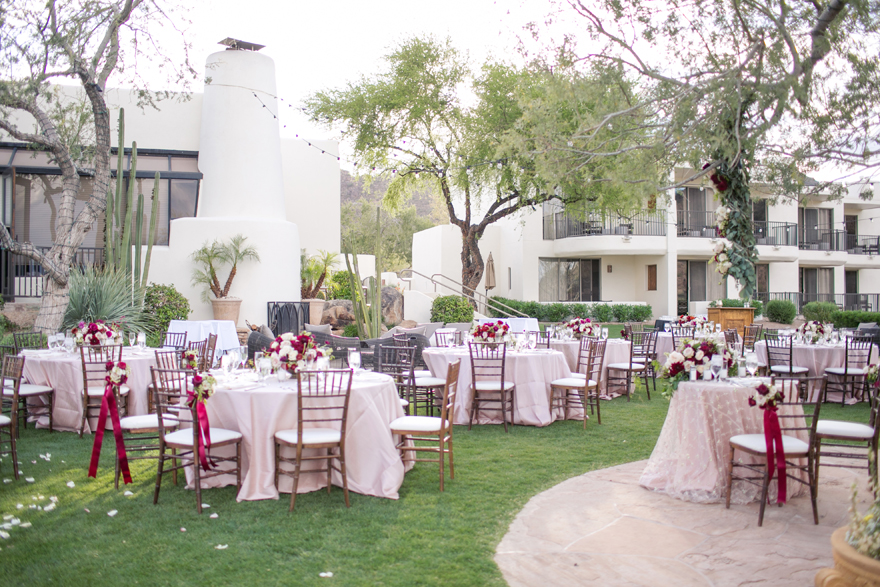 Elegant outdoor reception with burgundy flowers and blush linens. Arizona wedding