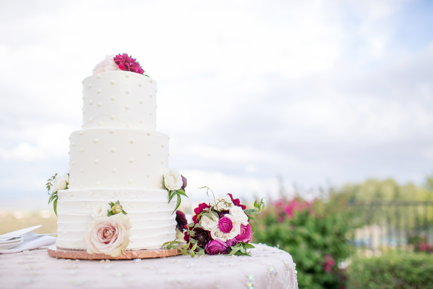 Elegant wedding cake with buttercream frosting and fresh flowers