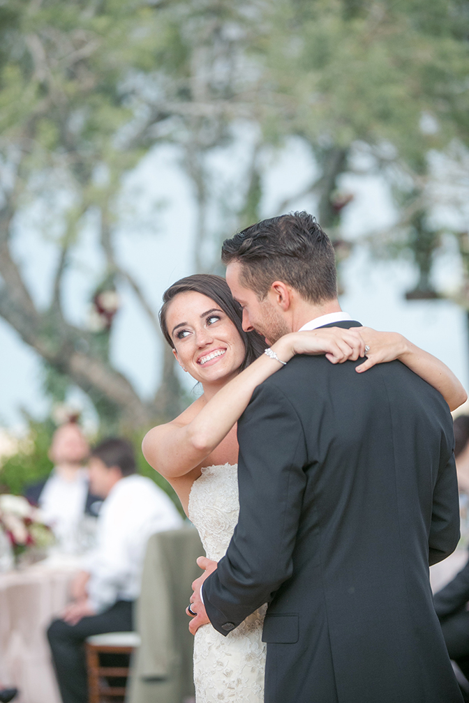 Happy bride & groom share their first dance in an outdoor wedding reception