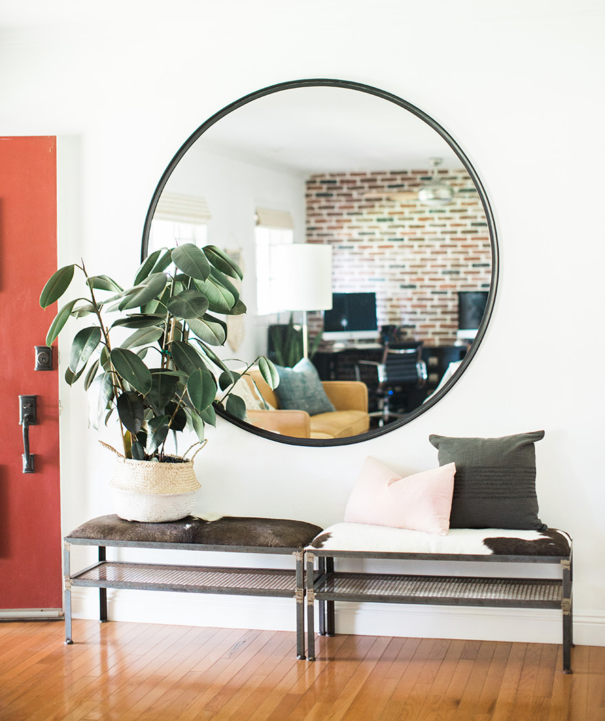 lounge mirror framed with black rubber, cowhide benches