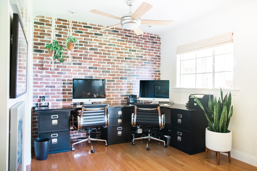 exposed brick wall and black furniture