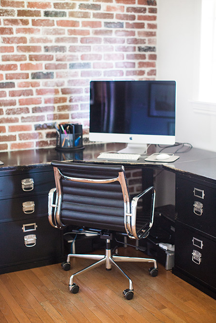 exposed brick wall and black desk
