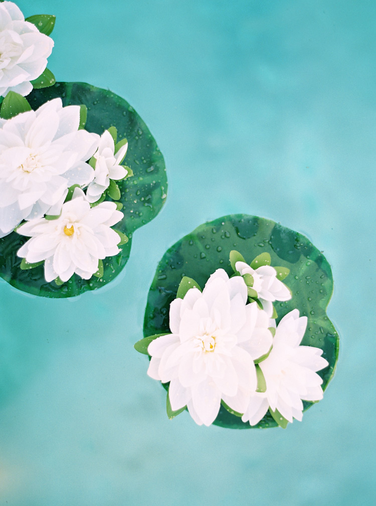 floating pool flowers for outdoor wedding
