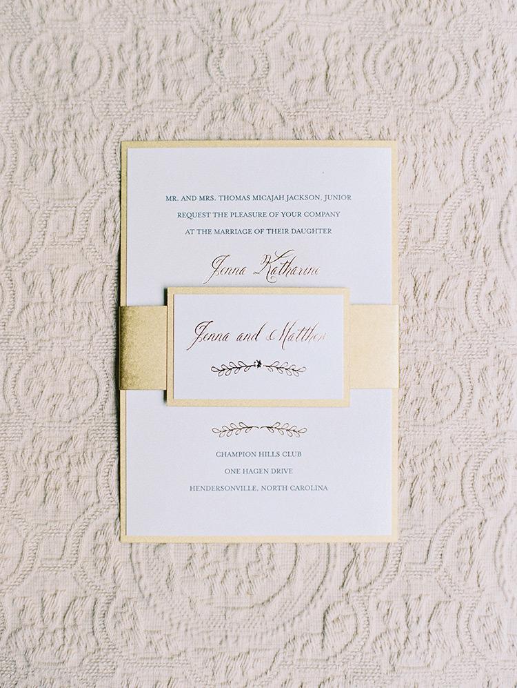 gold and white wedding invitation